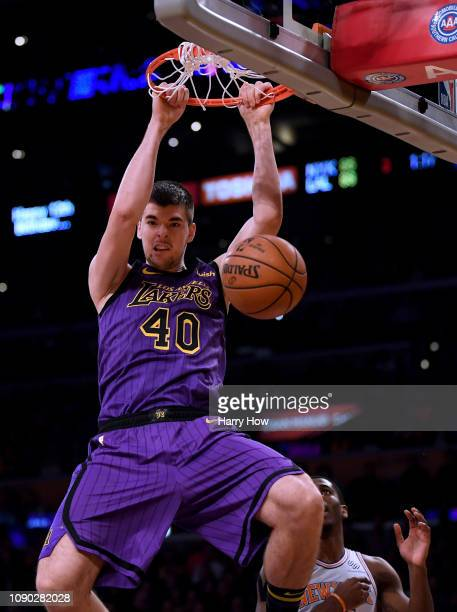 Ivica Zubac of the Los Angeles Lakers reacts to his dunk with Damyean Dotson of the New York Knicks during a 119112 Knicks win at Staples Center on...