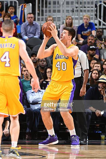 Ivica Zubac of the Los Angeles Lakers shoots the ball against the Golden State Warriors during a preseason game on October 15 2016 at the TMobile...