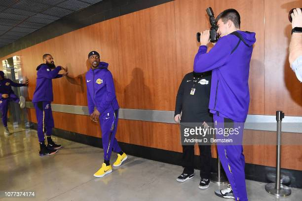 Ivica Zubac of the Los Angeles Lakers snaps a photo of Kentavious CaldwellPope of the Los Angeles Lakers prior to the game against the New York...