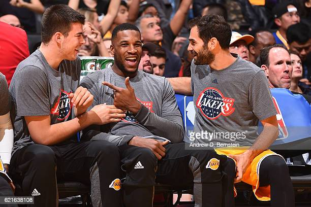 Ivica Zubac Tarik Black and Jose Calderon of the Los Angeles Lakers smile and laugh on the bench against the Golden State Warriors on November 4 2016...
