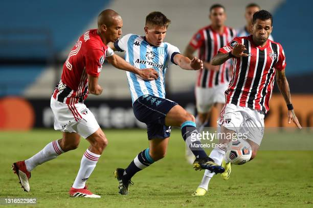 Iván Maggi of Racing Club fights for the ball with Miranda and Dani Alves of Sao Paulo during a match between Racing Club and Sao Paulo as part of...