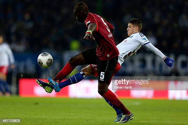 Ivo Ilicevic of Hamburg and Salif Sane of Hannover compete for the ball during the Bundesliga match between Hamburger SV and Hannover 96 at Imtech...
