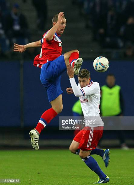 Ivo Ilicevic of Hamburg and Steven Whittaker of Glasgow battle for the ball during the friendly match between Hamburger SV and Glasgow Rangers at...