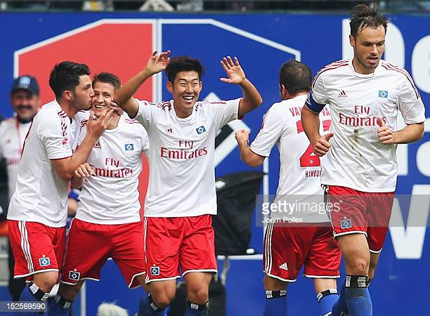 Ivo Ilicevic of Hamburg celebrates with his team mates after scoring his team's second goal during the Bundesliga match between Hamburger SV and...