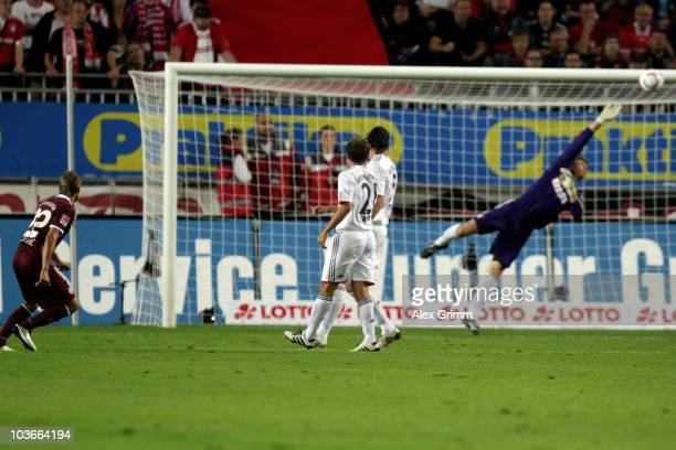 Ivo Ilicevic of Kaiserslautern scores his team's first goal against goalkeeper Hans Joerg Butt of Muenchen during the Bundesliga match between 1 FC...
