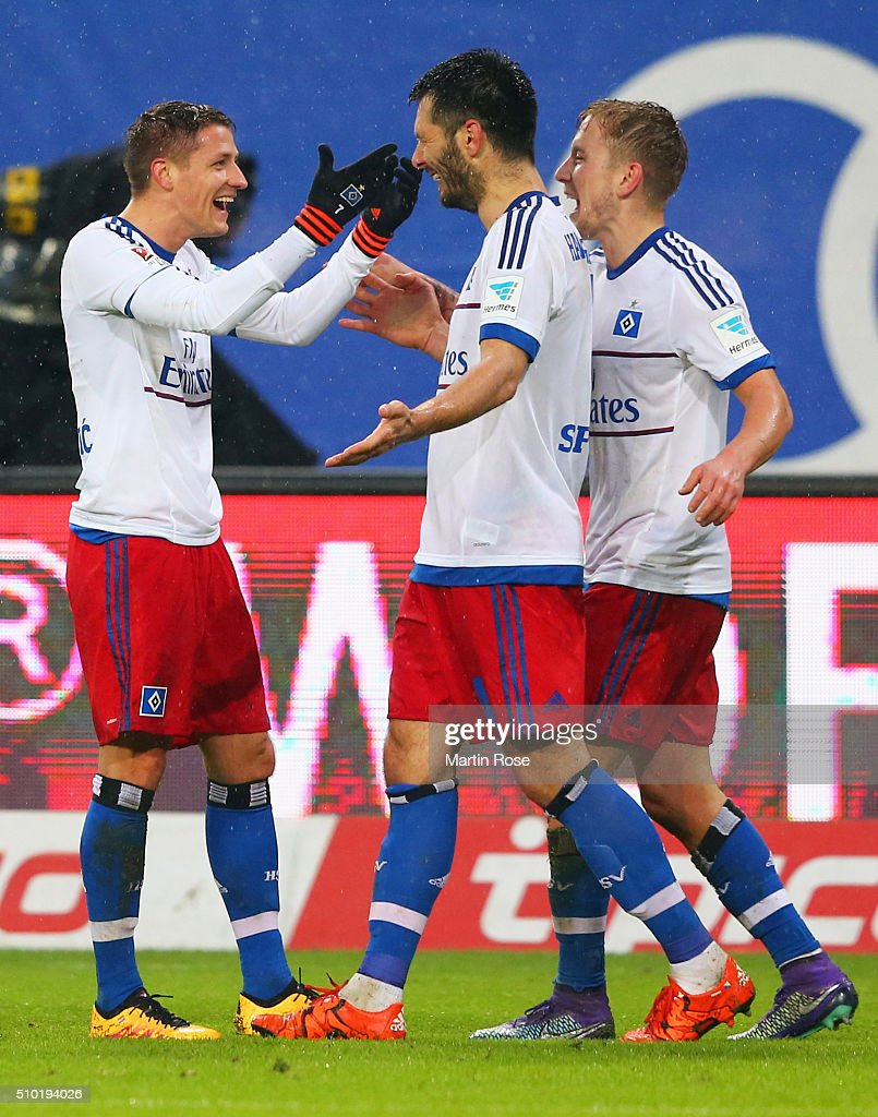 Ivo Ilicevic of SV Hamburg (L) celebrates with Emir Spahic (C) and Lewis Holtby (R) as he scores their third goal during the Bundesliga match between Hamburger SV and Borussia Moenchengladbach at Volksparkstadion on February 14, 2016 in Hamburg, Germany.