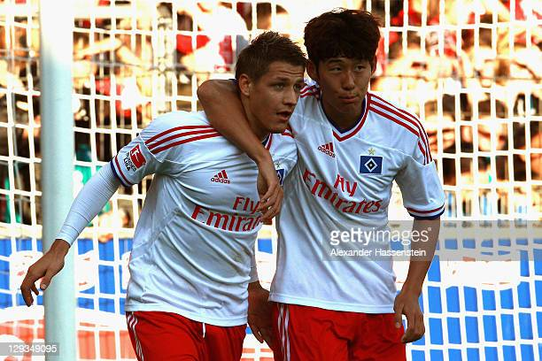 Ivo Illcevic of Hamburg celebrates scoring the 2nd team goal with his team mate Heung Min Son during the Bundesliga match between SC Freiburg and...
