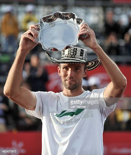 Ivo Karlovic of Coatia raise the trophy after finishing second during a tennis match between Ivo Karlovic of Croatia and Bernard Tomic of Australia...