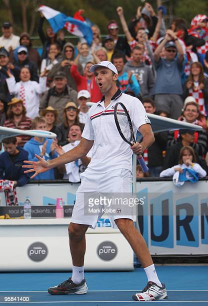 Ivo Karlovic of Croatia celebrates winning match point after his first round match against Radek Stepanek of the Czech Republic during day one of the...