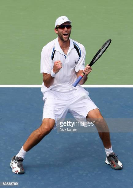 Ivo Karlovic of Croatia celebrates winning match point against Gael Monfils of France during day one of the Western & Southern Financial Group...