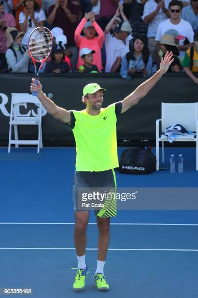 Ivo Karlovic of Croatia celebrates winning match point in his second round match against Yuichi Sugita of Japan on day three of the 2018 Australian...