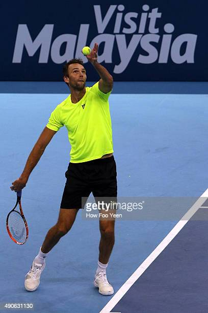 Ivo Karlovic of Croatia competes against Nikoloz Basilashvili of Geogia during the 2015 ATP Malaysian Open at Bukit Jalil National Stadium on...