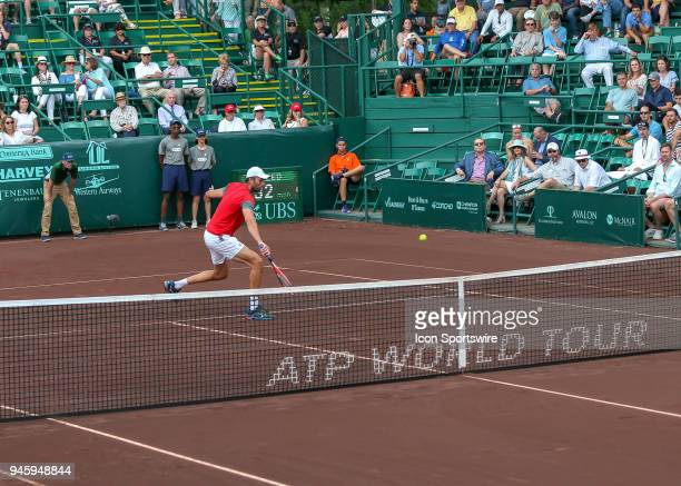 Ivo Karlovic of Croatia hits a return in the match against Nick Kyrgios of Australia during the Quarterfinal round of the Men's Clay Court...