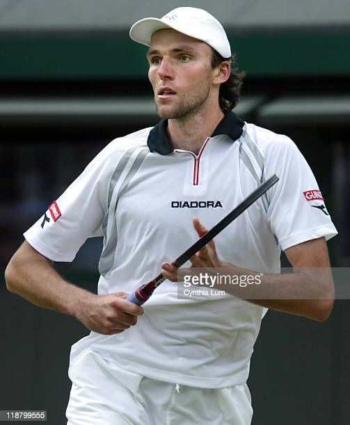 Ivo Karlovic of Croatia lost to Roger Federer of Switzerland 36 67 67 in the fourth round of the Wimbledon Championships in London Great Britain on...