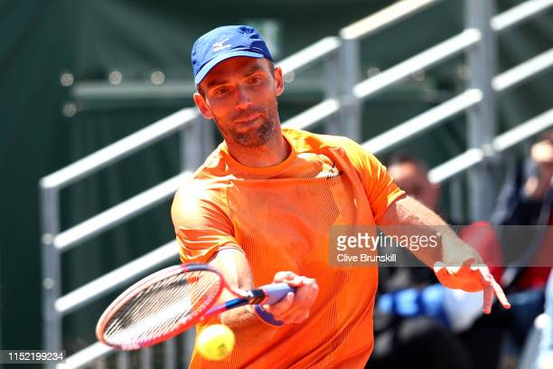 Ivo Karlovic of Croatia plays a forehand during his mens singles first round match against Feliciano Lopez of Spain during Day three of the 2019...