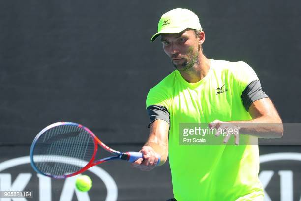 Ivo Karlovic of Croatia plays a forehand in his second round match against Yuichi Sugita of Japan on day three of the 2018 Australian Open at...