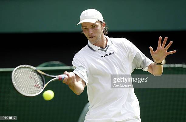 Ivo Karlovic of Croatia plays a forehand on his way to victory over defending champion Lleyton Hewitt of Australia during the opening day of the...