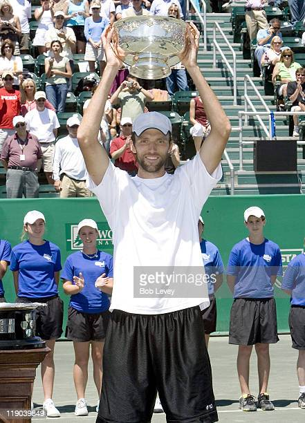 Ivo Karlovic of Croatia poses with the trophy after beating Mariano Zabaleta of Argentina during the finals of the US Men's Clay Court Championships...