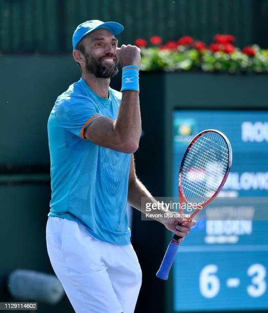 Ivo Karlovic of Croatia reacts after winning the first set tie breaker against Matthew Ebden of Australia during the men's singles first round match...