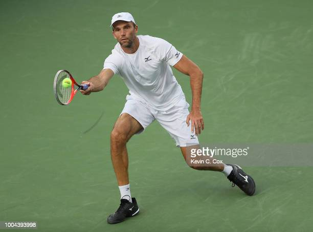 Ivo Karlovic of Croatia returns a forehand to Donald Young during the BBT Atlanta Open at Atlantic Station on July 23 2018 in Atlanta Georgia