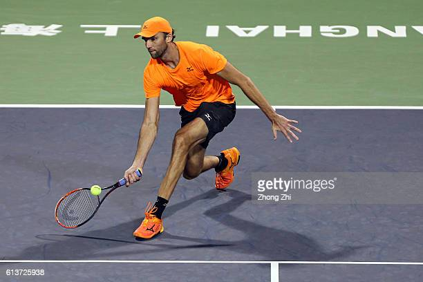 Ivo Karlovic of Croatia returns a shot during the match against Vasek Pospisil of Canada on Day 2 of the ATP Shanghai Rolex Masters 2016 at Qi Zhong...