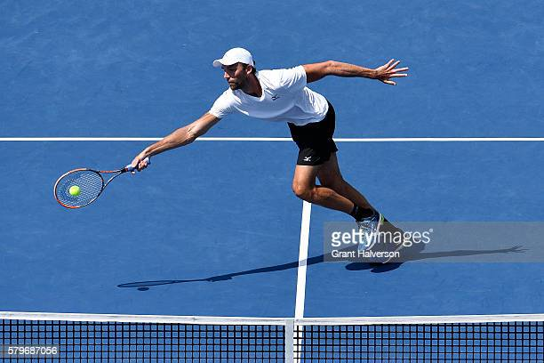 Ivo Karlovic of Croatia returns a shot to Gael Monfils of France in the men's singles final of the Citi Open at Rock Creek Tennis Center on July 24...
