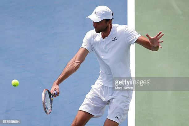 Ivo Karlovic of Croatia returns a shot to Jack Sock of the United States of America during day 5 of the Citi Open at Rock Creek Tennis Center on July...