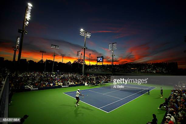 Ivo Karlovic of Croatia returns a shot to Marcel Granollers of Spain during their men's singles second round match on Day Five of the 2014 US Open at...