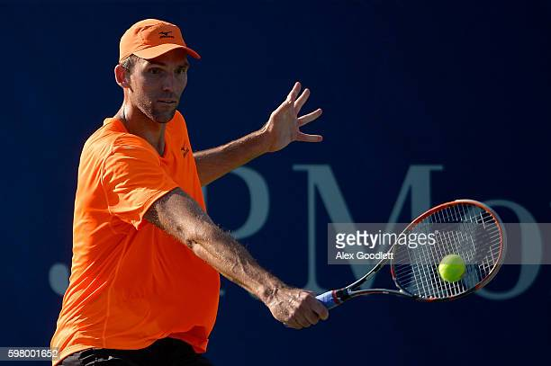 Ivo Karlovic of Croatia returns a shot to YenHsun Lu of Taipei during his first round Men's Singles match on Day Two of the 2016 US Open at the USTA...