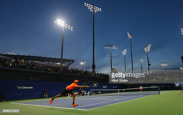 Ivo Karlovic of Croatia returns a shot to Yen-Hsun Lu of Taipei during his first round Men's Singles match on Day Two of the 2016 US Open at the USTA...