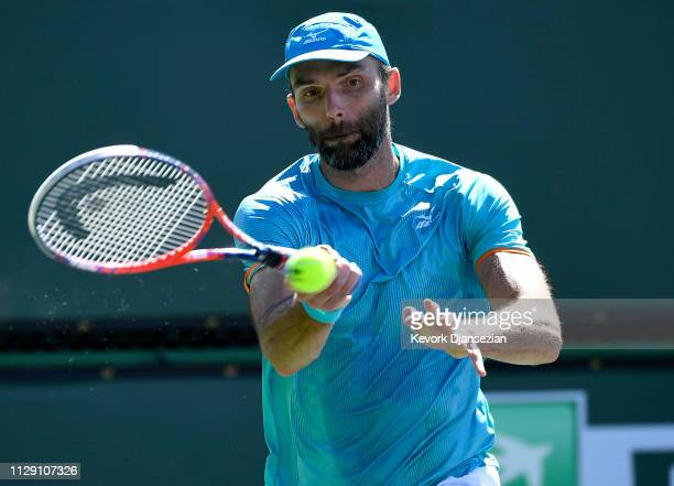 Ivo Karlovic of Croatia returns against Ivo Matthew Ebden of Australia during the mens singles first round match on day four of the BNP Paribas Open...