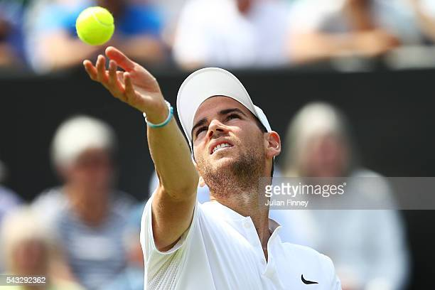 Ivo Karlovic of Croatia serves during the Men's Singles first round match against Borna Coric of Croatia on day one of the Wimbledon Lawn Tennis...