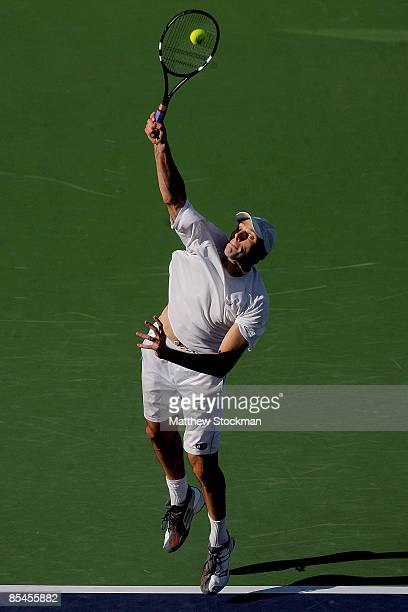 Ivo Karlovic of Croatia serves to Roger Federer of Switzerland during the BNP Paribas Open at the Indian Wells Tennis Garden March 16 2009 in Indian...