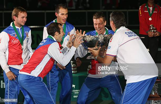 Ivo MinarLukas RosolRadek StepanekTomas Berdych and team captain Jaroslav Navratil of Czech Republic about to lift the winners trophy aloft after a...