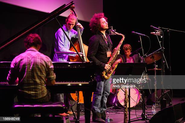 Ivo Neame Jasper Hoiby Adam Waldman and Jon Scott of the band Kairos 4Tet performs on stage at Kings Place during the London Jazz Festival 2012 on...