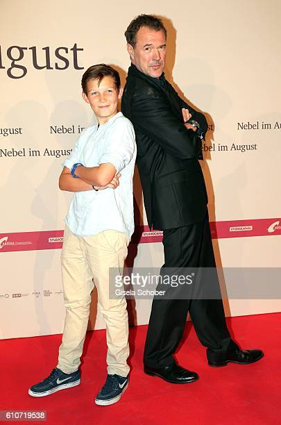 Ivo Pietzcker and Sebastian Koch during the premiere of the film 'Nebel im August' at City Kino on September 27 2016 in Munich Germany