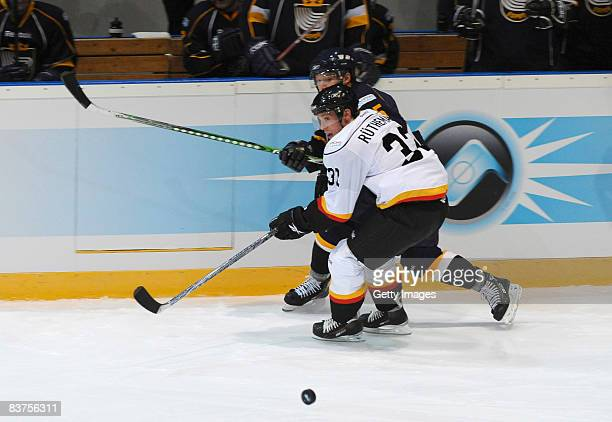 Ivo Ruthemann of Bern fights for the puck during the IIHF Champions Hockey League match between Espoo Blues and SC Bern on November 19, 2008 in...