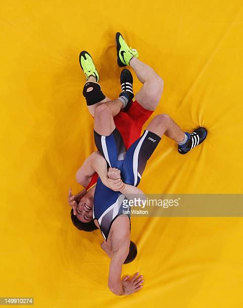 Ivo Serafimov Angelov of Bulgaria competes against Jiang Sheng of China during the Men's GrecoRoman 60 kg Wrestling Repechage on Day 10 of the London...
