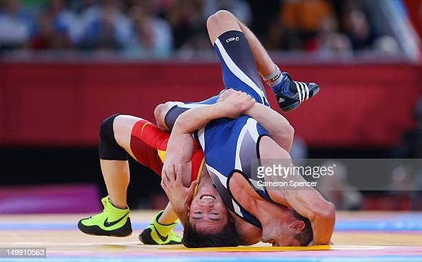 Ivo Serafimov Angelov of Bulgaria competes against Jiang Sheng of China during the Men's Greco-Roman 60 kg Wrestling Repechage on Day 10 of the...