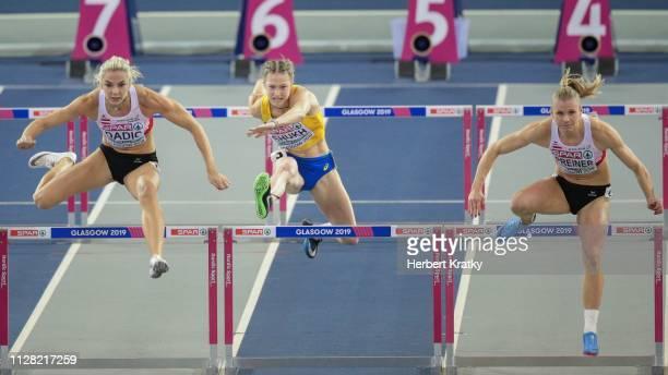 Ivona Dadic of Austria Alina Shukh of the Ukraine and Verena Preiner of Austria compete in the 60m hurdles event of the women's pentathlon on March 1...