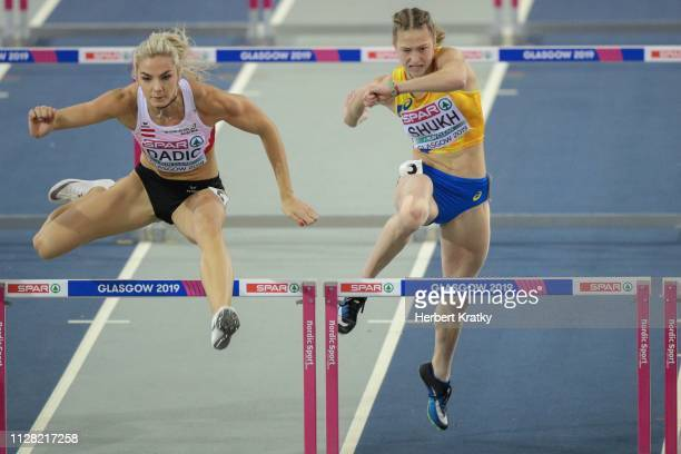 Ivona Dadic of Austria and Alina Shukh of the Ukraine compete in the 60m hurdles event of the women's pentathlon on March 1 2019 in Glasgow United...
