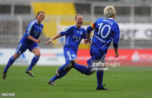 Ivonne Hartmann of Jena celebrates the first goal with teammates during the DFB women's cup half final match between FF USV Jena and SG...