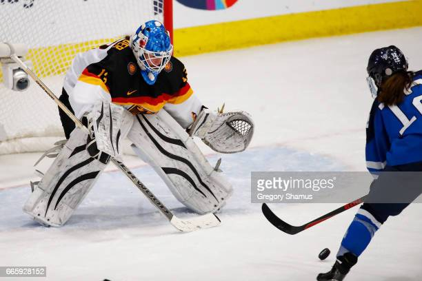Ivonne Schroder of Germany yes the puck on the stick of Susanna Tapani of Finland during the first period in the bronze medal game at the 2017 IIHF...