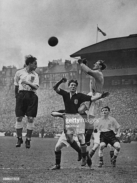 Ivor Broadis of England attempts to head the ball but is beaten to it by Bobby Brown the Scotland goalkeeper during the 1951–52 British Home...
