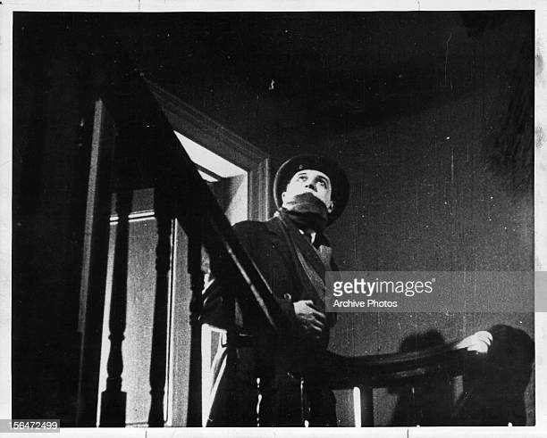Ivor Novello looks up the stairs in a scene from the film 'The Lodger A Story Of The London Fog' 1927