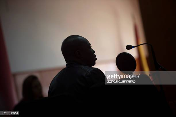 Ivorian Ali Ouattara sits in court during his trial in Ceuta a Spanish overseas territory in northern Morocco on February 20 2018 Prosecutors are...