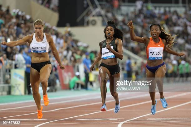 Ivorian athlete Marie-Josee Ta Lou crosses the finish line to win the women's 100 metres next to Jamaican Elaine Thompson and Dutch Dafne Schippers...