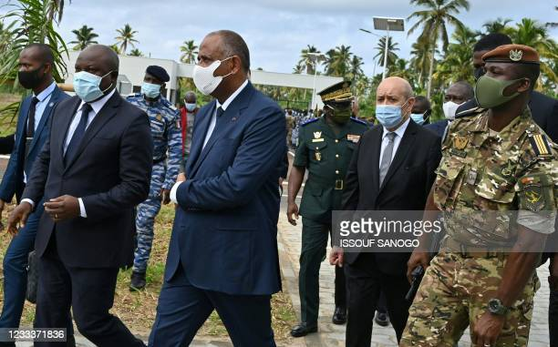 Ivorian defense Minister Tene Birahima Ouattara , Ivorian Prime Minister Patrick Achi and French foreign Minister Jean-Yves Le Drian arrives at the...