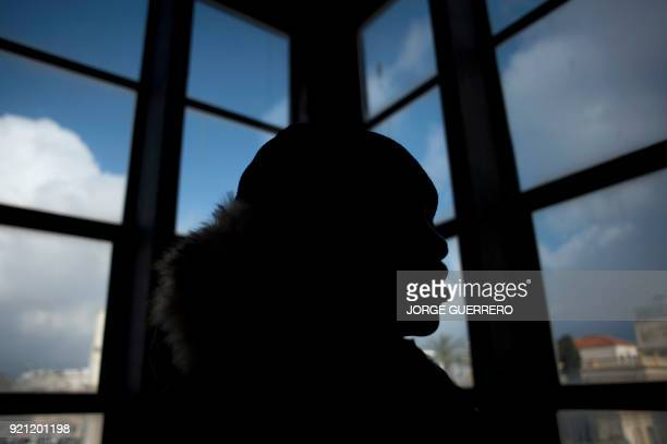 Ivorian eightyearold Adou Ouattara waits during his father's trial in Ceuta a Spanish overseas territory in northern Morocco on February 20 2018...