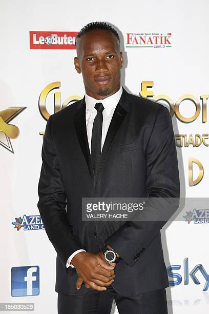 Ivorian football player Didier Drogba poses on October 16 2013 in Monaco for the 2013 Golden Foot Award Gala The Golden Foot award is an...